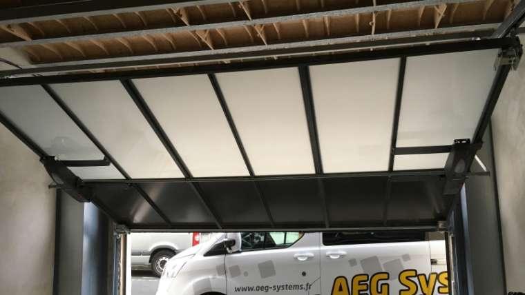 Pose d'une porte de garage basculante